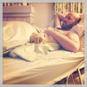 Mike and our dog, Jetty, relaxing on his hospital bed.