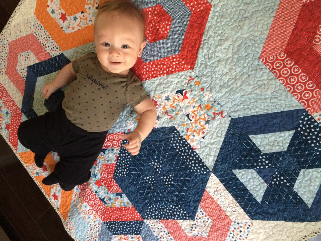 Of course, I had to include a picture of a baby using the baby quilt!
